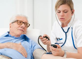 CNA Taking Blood Pressure