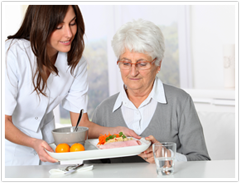 Home Health Aide Serving Food